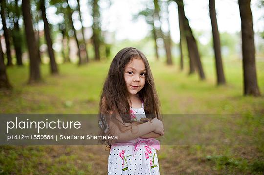 Portrait of a little girl in the park - p1412m1559584 by Svetlana Shemeleva