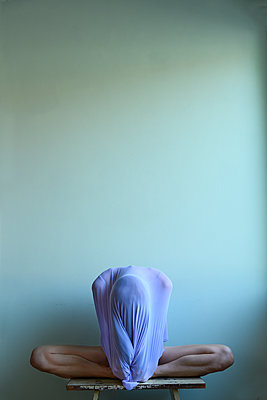 Woman with sweater over face - p427m2210317 by Ralf Mohr