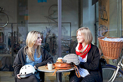 Women having coffee together outdoors - p924m807253f by Sydney Bourne