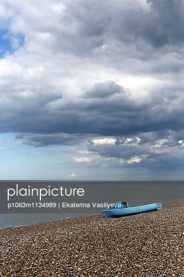Blue boat on beach - p1063m1134989 by Ekaterina Vasilyeva