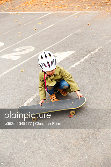 Sweden, Sodermanland, Jarna, Girl (4-5) with skateboard in skatepark
