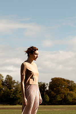 Woman Standing in Field  - p1248m2076331 by miguel sobreira