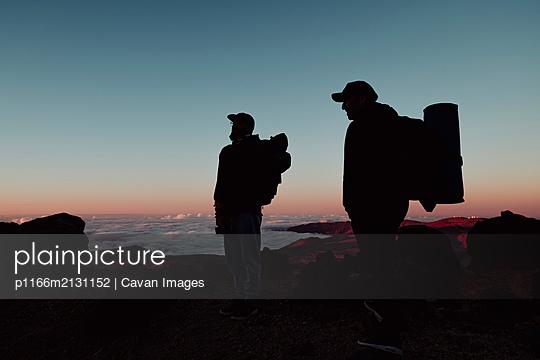 Hikers enjoying sunset in El Teide, Tenerife - p1166m2131152 by Cavan Images