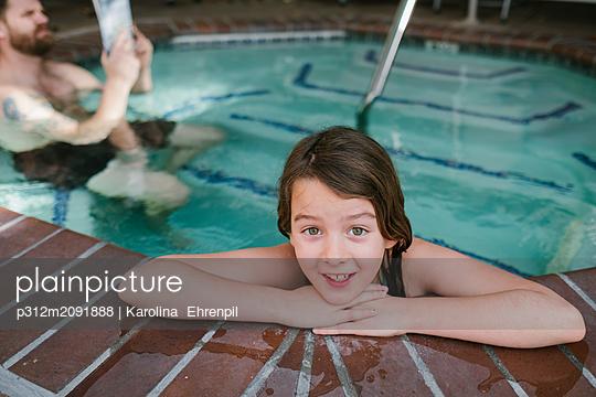 Girl in swimming-pool - p312m2091888 by Karolina  Ehrenpil