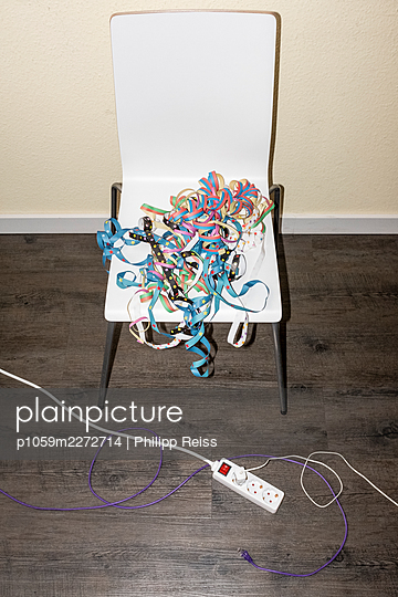 Paper streamers on a chair - p1059m2272714 by Philipp Reiss