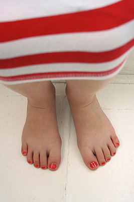 Little girl's red painted toes - p1072m830541 by Gail Symes