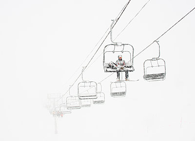 Ski Patroller in white out conditions at Arapahoe Basin Ski Resort in Summit County, Colorado - p343m1218260 by Jon Paciaroni