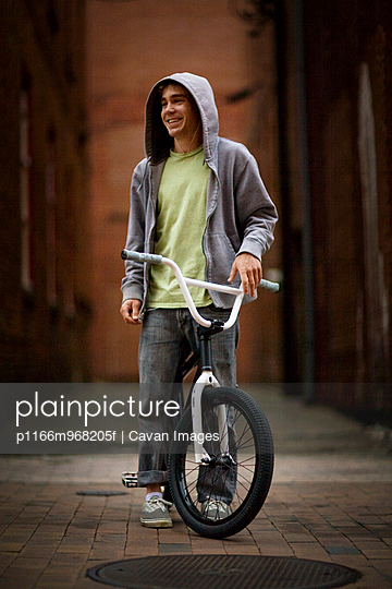 portrait of BMX biker in alley