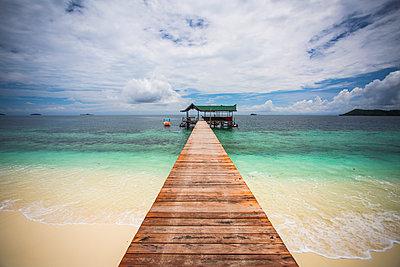 Scenic view of pier at Raja Ampat Islands against cloudy sky - p1166m1489693 by Cavan Images