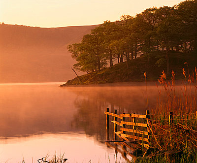 Mist rising on Derwent Water at dawn, Lake District National Park, Cumbria, England, United Kingdom, Europe - p8710098 by Nigel Blythe