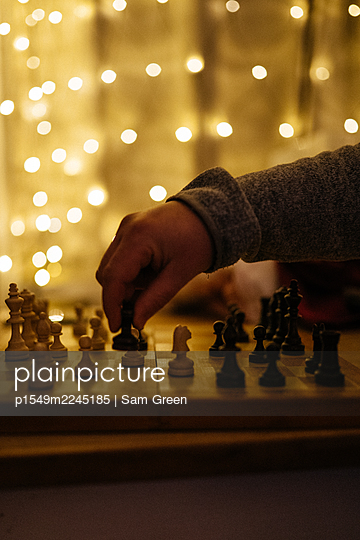 Chess player makes a move - p1549m2245185 by Sam Green