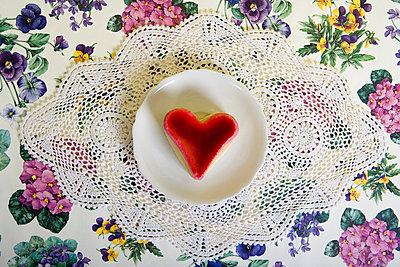 A heart shaped cake on a plate - p3016818f by Serge