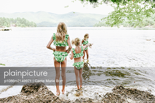 Siblings by the bathing lake - p1086m2149971 by Carrie Marie Burr