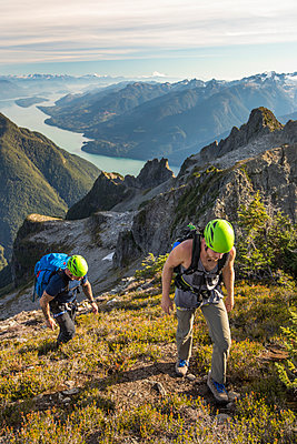 Two climbers approach the summit of Douglas Peak, British Columbia. - p1166m2095179 by Cavan Images