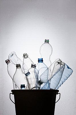 Bottles in bucket - p301m714371f by Larry Washburn