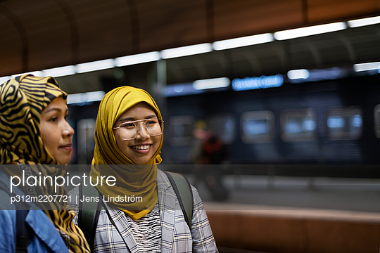 Female friends on train station - p312m2207721 by Jens Lindström