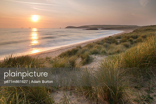 Sunset over Constantine Bay in North Cornwall - p871m861627 by Adam Burton