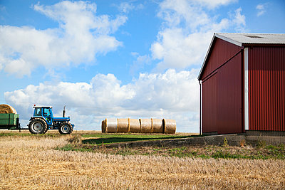 Tractor with bales of hay - p312m957192f by Lina Karna Kippel