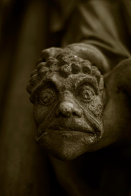 Frightening face on medieval church tympanum, Paris, France - p1028m2021689 by Jean Marmeisse