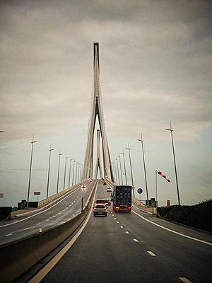 Pont de Normandie under cloudy sky - p1072m829234 by Neville Mountford-Hoare