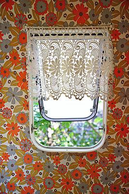 Open window of a caravan - p1231m2184713 by Iris Loonen