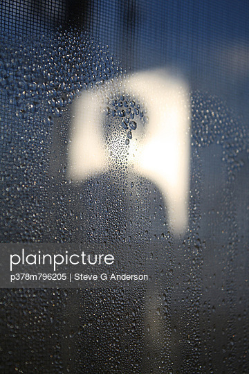 Silhouette on rainy window - p378m796205 by Steve G Anderson