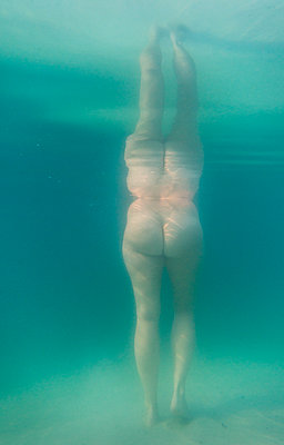 Nude in a lake - p1132m1171396 by Mischa Keijser