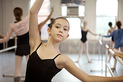 Girl in ballet class - p9245506f by Image Source