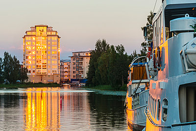 Buildings at water, dusk - p312m1024765f by Mikael Svensson