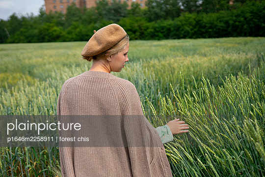 Young woman in wheat field - p1646m2258911 by Slava Chistyakov