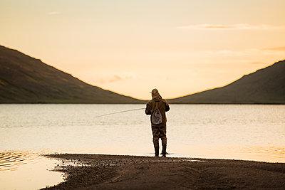 Man fishing in lake - p312m2051362 by Hans Berggren
