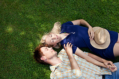 A nap on the lawn - p981m881557 by Franke + Mans