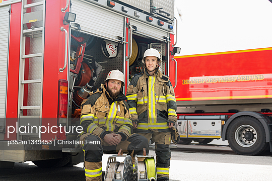 Sweden, Sodermanland, Firefighters in front of fire truck
