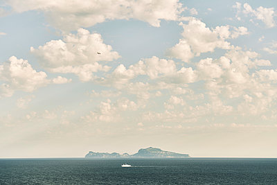 Capri Island and fleecy clouds - p968m2207458 by roberto pastrovicchio