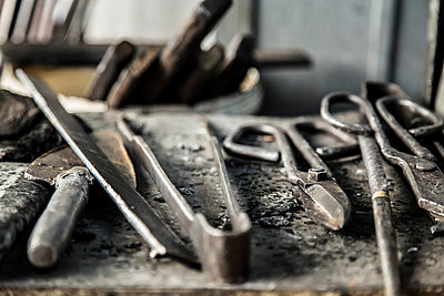 Close-up of work tools at glass factory - p1166m1486018 by Cavan Images
