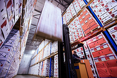 Moving forklift in factory hall loading boxes - p300m2104335 by zerocreatives