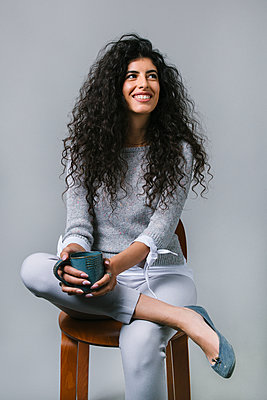Portrait smiling, happy woman drinking coffee - p1192m2123256 by Hero Images
