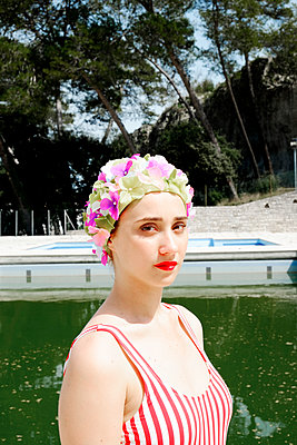 Young woman with bathing cap - p1521m2081632 by Charlotte Zobel