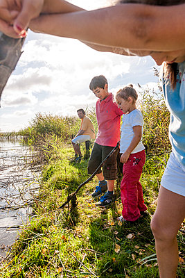 Children playing at water course, Darss, Mecklenburg-Western Pomerania, Germany - p300m2143727 by Ega Birk