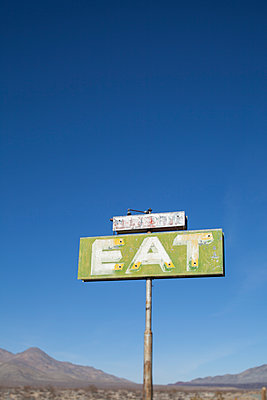 Old roadside sign in desert - p343m1475830 by Woods Wheatcroft photography