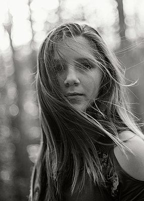 Girl with blowing hair - p1503m2031820 by Deb Schwedhelm