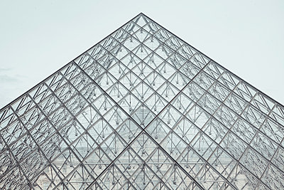 France, Paris, Louvre, part of glass pyramid in front of the old building - p300m1157868 by Zeljko Dangubic