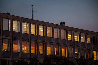 Office Building With Lighted Windows At Night    - p847m1102438 by Johan Strindberg