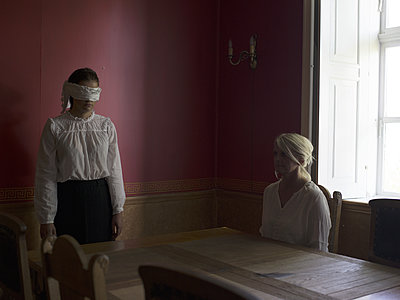 Woman and blindfolded teenager - p945m1163020 by aurelia frey