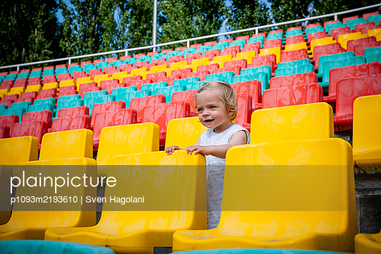 Toddler girl in a stand, Friedrich-Ludwig-Jahn-Sportpark - p1093m2193610 by Sven Hagolani