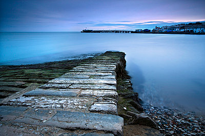 Stone jetty and new pier at dawn, Swanage, Dorset, England, United Kingdom, Europe - p8710549 by Lee Frost