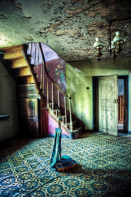 Abandoned hallway with old vacuum cleaner - p92411285f by David Pinzer Photography