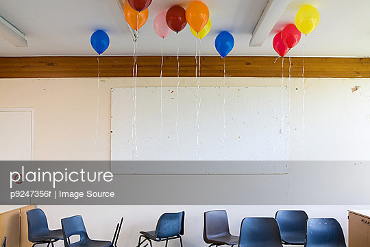 Balloons in classroom - p9247356f by Image Source