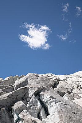 Small white cloud over a glacier - p1682m2263431 by Régine Heintz