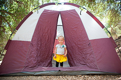 Young female toddler in tent doorway - p924m825982f by Jade Brookbank